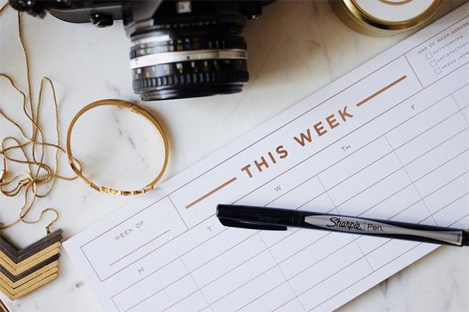 calendar and pen. planning strategies for social media.