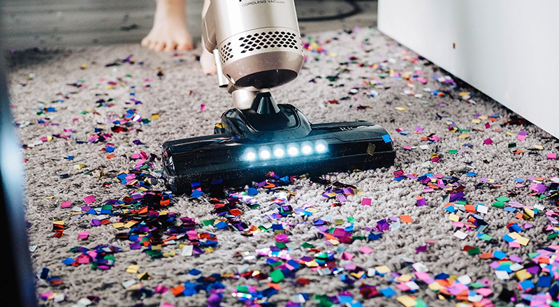 vacuuming carpet after party- Common Property Management Problems- Zeevou