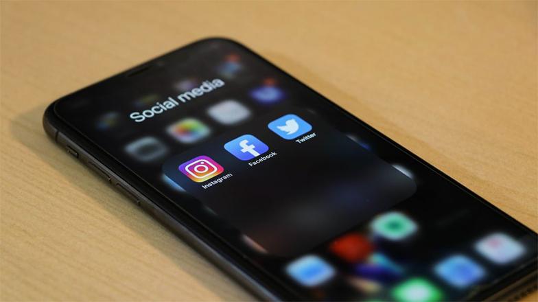 iPhone with social media apps on it- Zeevou