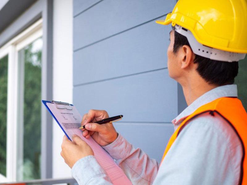 A man doing Rental Property Maintenance Checklist- Zeevou