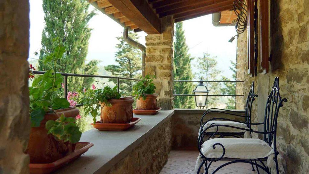 A short term rental with flower pots- Long-term Rental vs Short-term Rental Management From the Same System- Zeevou